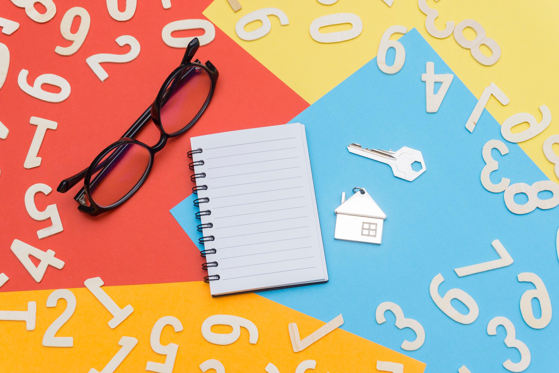eyeglasses-near-notebook-and-metal-key-1314549